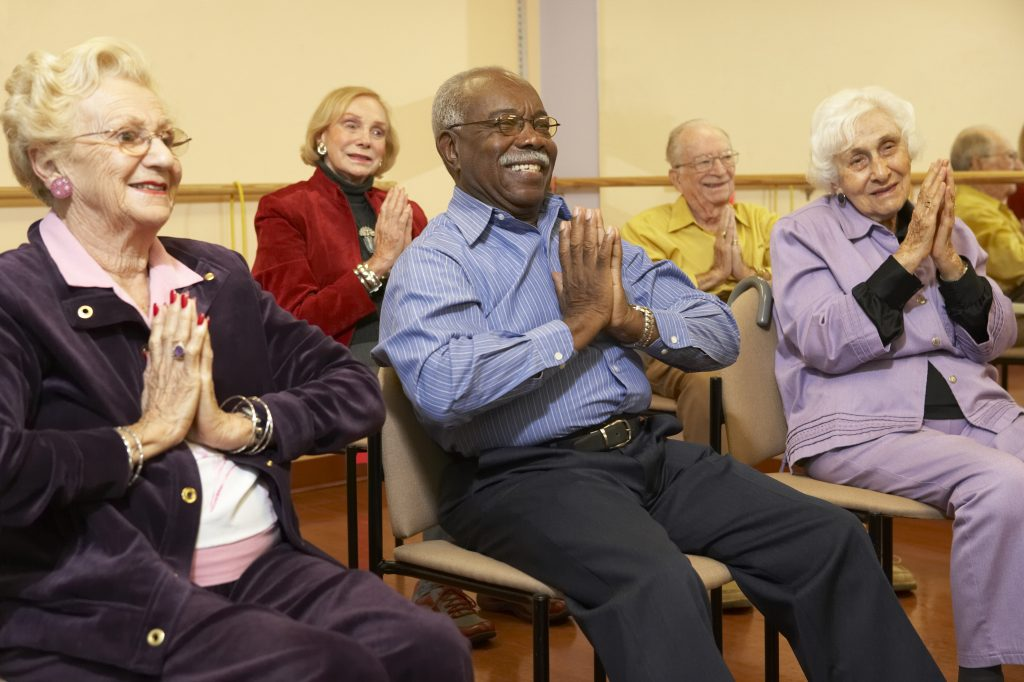 6 Senior adults in a stretching class keeping fit