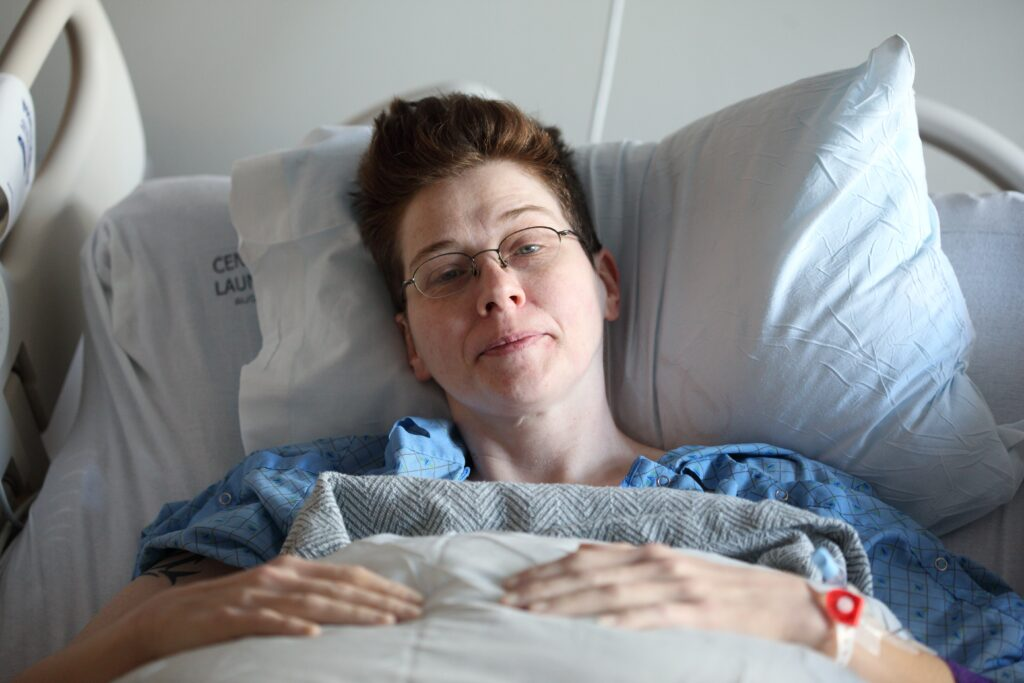 Complex care being delivered to woman sitting in bed