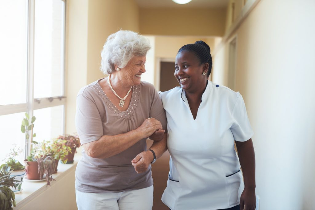 Smiling home caregiver
