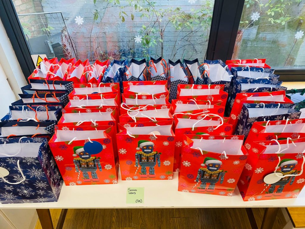Blue and red bags on a table filled with Christmas meal